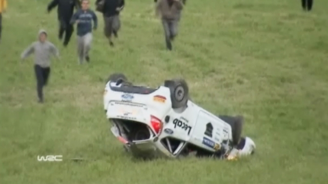 On tape: Race car crashes, lands upside-down