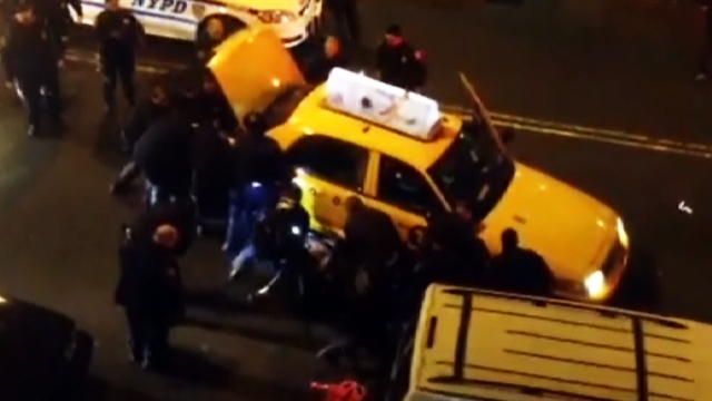 U.s.: NYPD officers lift taxi to free man