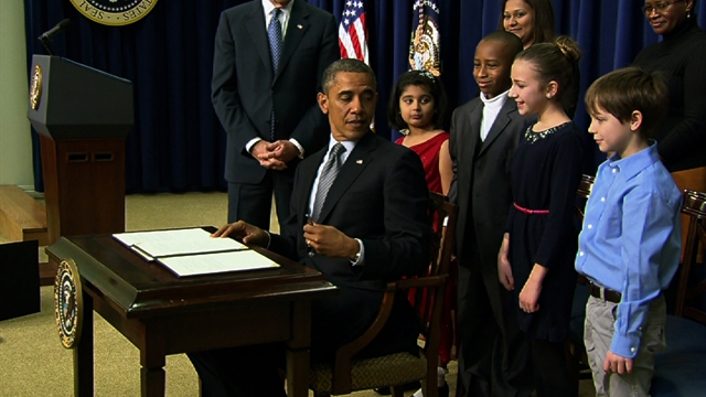 Politics: Obama signs orders to help prevent gun violence