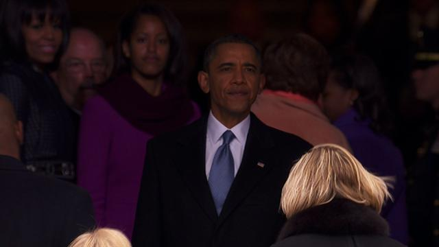 Politics: Obama takes in inauguration crowd