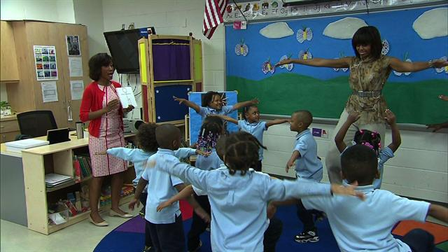 Politics: Michelle Obama gets her groove on with school kids
