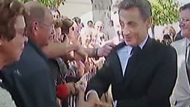 Sarkozy scuffle during handshake tour