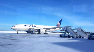 CBS This Morning - Stranded United travelers spend night on jet