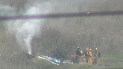 CBS This Morning - Feds look for answers at Bryant crash site