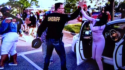 CBS This Morning - Sheriff walks with protesters in Michigan